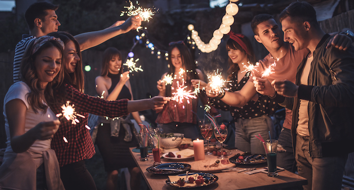 imagestock_iStock-945885714_family-friends-celebrating-christmas-new-years-holiday-party-resized-700w