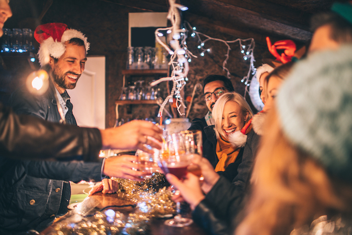 image-stock-iStock-860638492-christmas-new-years-party-drinking-resized-700w